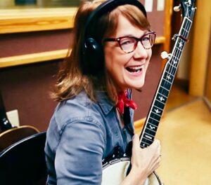 Musician Paula Bradley with a banjo